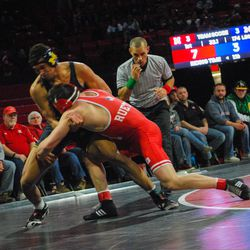 Nebraska's Mikey Labriola takes down Michigan's Max Maylor in their 174-pound match Friday at the Devaney Sports Center