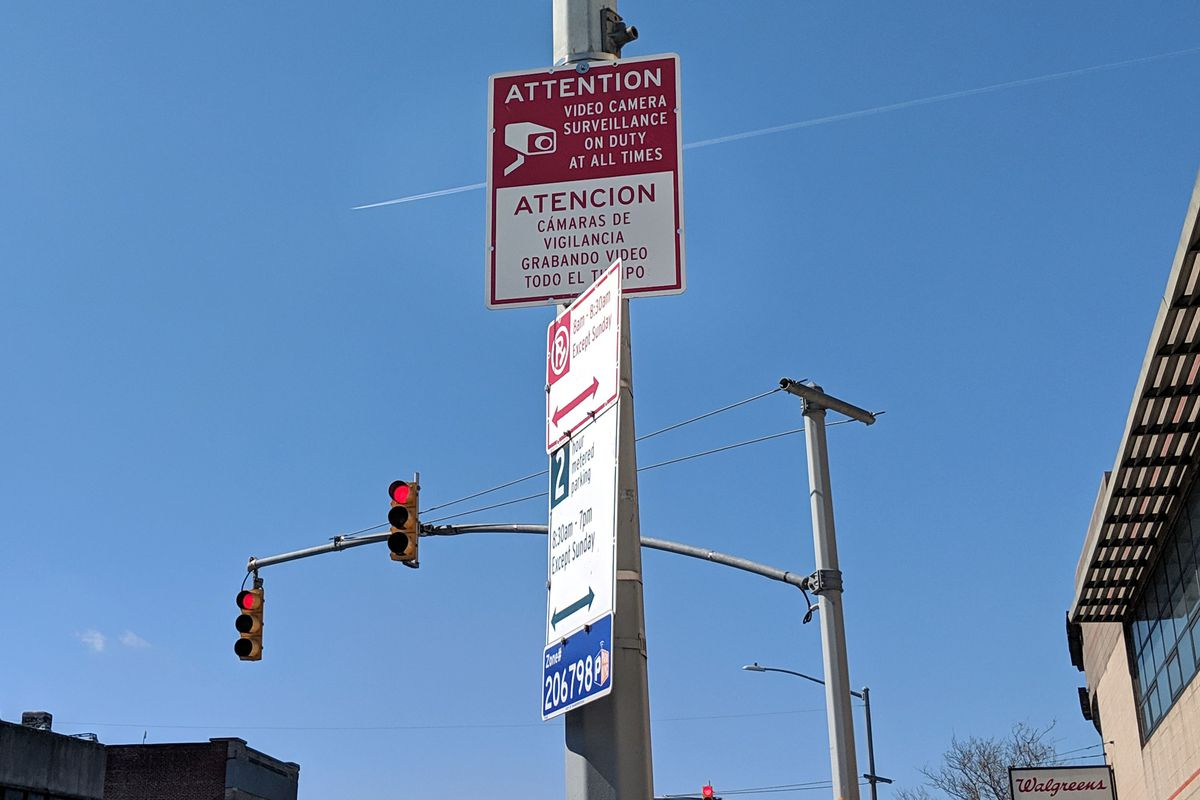 A sign in The Bronx's Westchester Square informs passersby that video surveillance is in use. April 6, 2020.