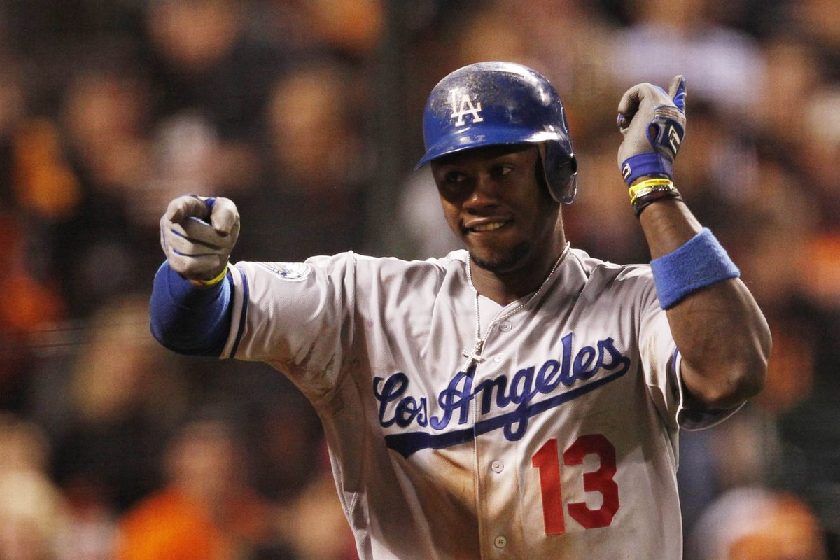 July 27, 2012; San Francisco, CA, USA; Los Angeles Dodgers third baseman Hanley Ramirez celebrates after hitting a two-run home run during the tenth inning against the San Francisco Giants at AT&T Park. Mandatory Credit: Beck Diefenbach-US PRESSWIRE