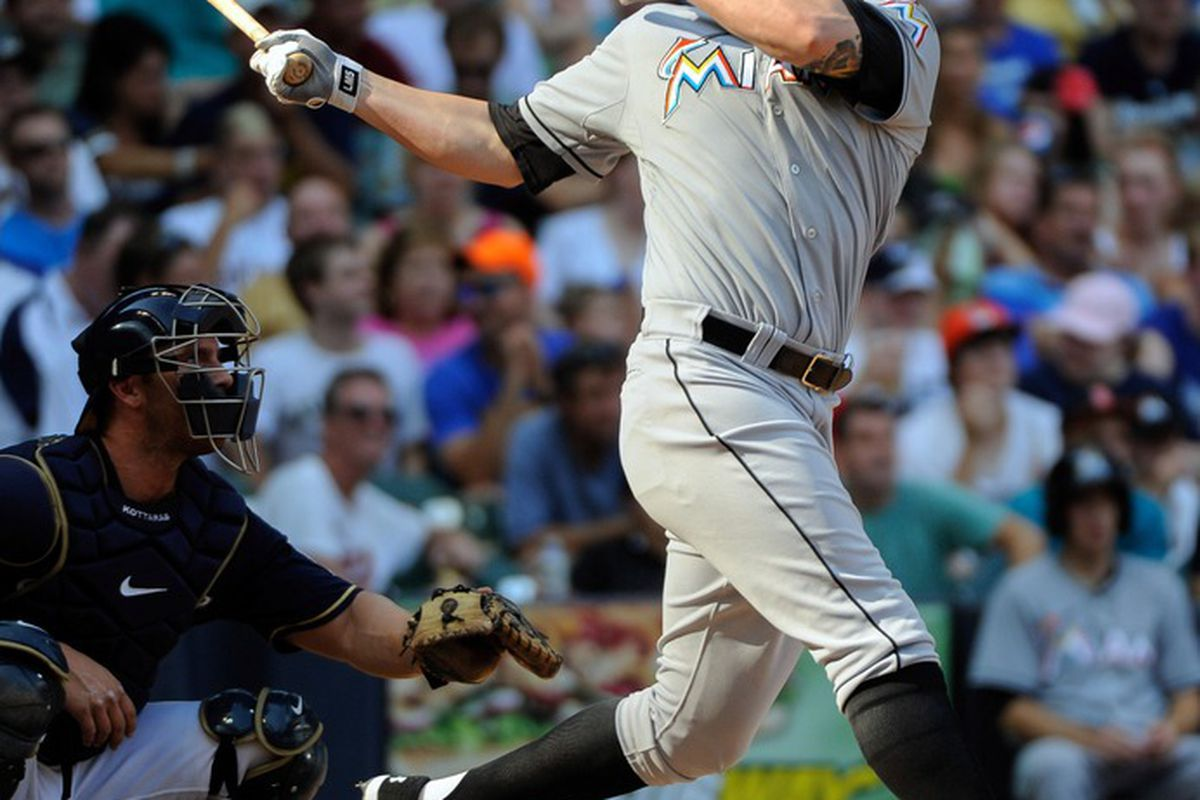 July 4, 2012; Milwaukee, WI, USA;  Miami Marlins pinch hitter Logan Morrison (5) hits a 3-run home run in the seventh inning against the Milwaukee Brewers at Miller Park. Mandatory Credit: Benny Sieu-US PRESSWIRE