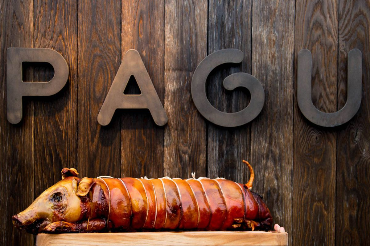 Pagu's signage and a whole pig