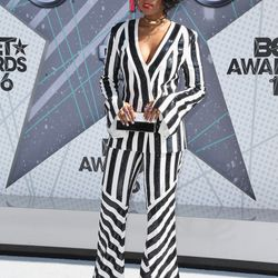 Janelle Monae in a Sass & Bide two-piece suit, Jennifer Fisher earrings and choker, and Le Vian rings