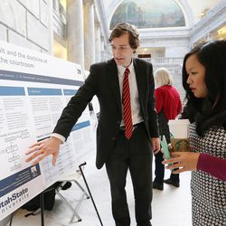 Ryan Wallentine shows his project to Chanapa Tantibanchachai as University of Utah and Utah State University students show their research for Utah lawmakers in rotunda of the state Capitol in Salt Lake City, Tuesday, Jan. 26, 2016.