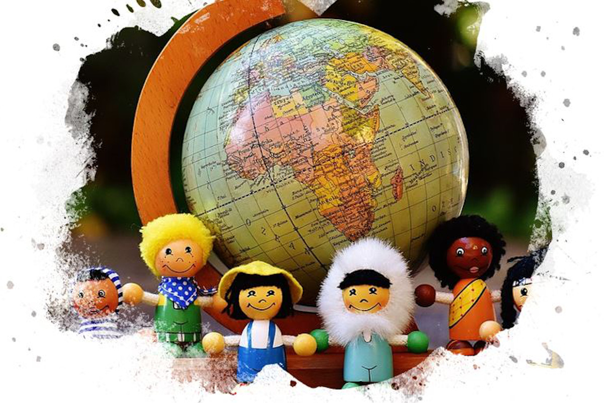 Six small dolls stand in a circle around a globe.
