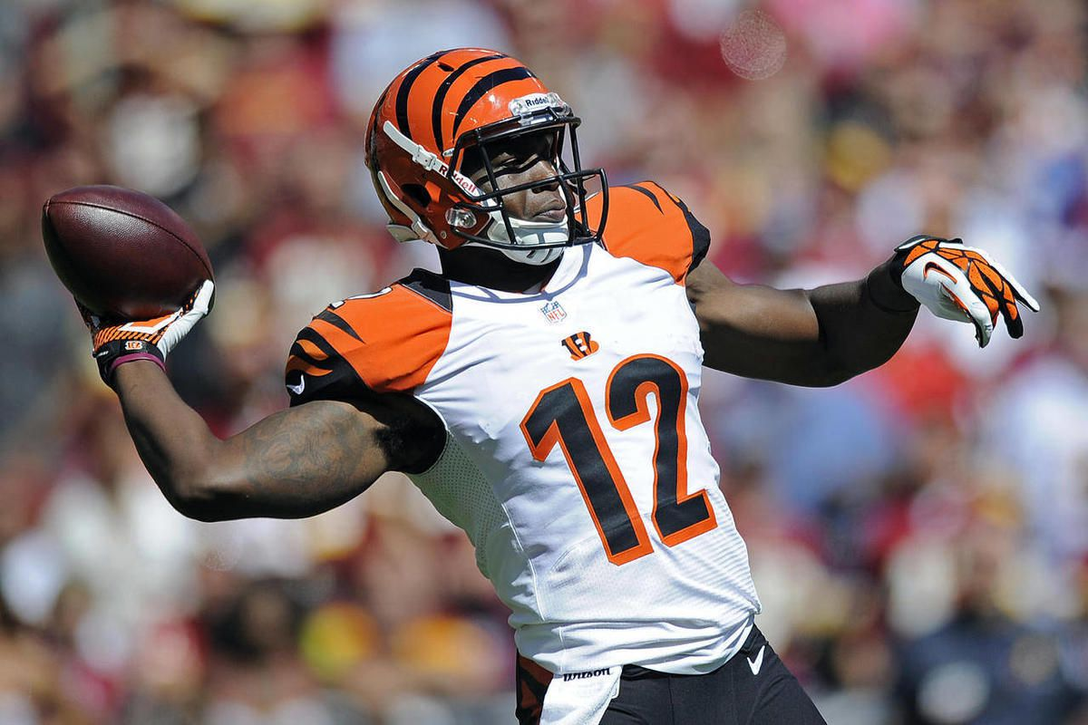 Cincinnati Bengals wide receiver Mohamed Sanu throws a touchdown pass during the first half of an NFL football game against the Washington Redskins in Landover, Md., Sunday, Sept. 23, 2012.