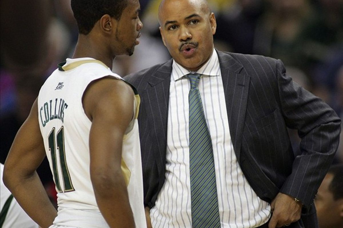 Feb 26, 2012; Tallahassee, FL, USA; South Florida Bulls head coach Stan Heath (right) talks to South Florida Bulls guard Anthony Collins (11) in the first half of their game at the Tampa Bay Times Forum. Mandatory Credit: Phil Sears-US PRESSWIRE