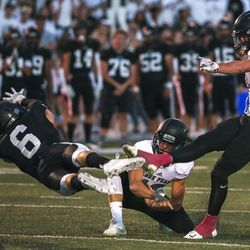 Highland's Ben Neilson just misses blocking a field goal by Lone Peak kicker Nate Ritchie during football game at Highland High School in Salt Lake City on Friday, Sept. 7, 2018.