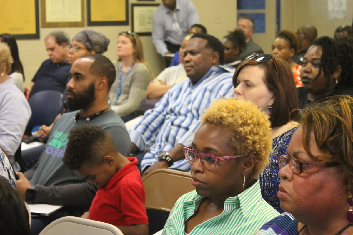 Educators and parents listen during one of nine community meetings held in 2016 to explore the future of Memphis schools.