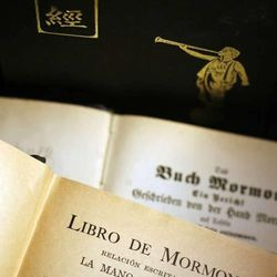 Historic title pages of the Book of Mormon in German and Spanish with a Chinese edition in the background.