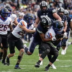 Boise State safety Alexander Teubner, right, gets tackled by BYU wide receiver Keanu Hill during an NCAA college football game at LaVell Edwards Stadium in Provo on Saturday, Oct. 9, 2021.