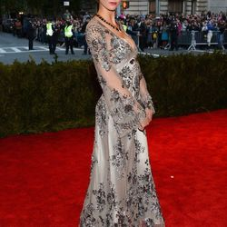 Karlie Kloss in hair she spray painted and a Louis Vuitton gown