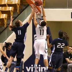 """Xojian Harry grabs a defensive rebound for the Cougars in their game against San Diego in Provo January 24, 2015.  <img src=""""http://beacon.deseretconnect.com/beacon.gif?cid=245925&pid=7"""" />"""