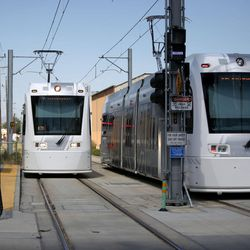 An S-Line streetcar passes another streetcar on a small section of double track in South Salt Lake on Tuesday, June 27, 2017. S-Line trains currently run on a single track from the Central Pointe TRAX Station to Fairmont Station at 1040 East. The new funding would allow for the line to be double-tracked in South Salt Lake between 300 and 500 East, allowing streetcars to pass by each other in the middle of their route on the fly. Currently, the system requires one S-Line streetcar to pull onto a side track and stop, while another streetcar moves past it.