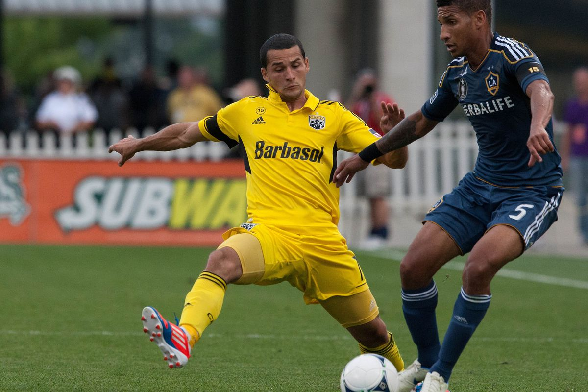 Aug 15, 2012; Columbus, OH, USA; Columbus Crew midfielder Dilly Duka (11) attempts to block a pass from Los Angeles Galaxy defender Sean Franklin (5) during the match at Crew Stadium. Mandatory Credit: Rob Leifheit-US PRESSWIRE