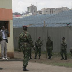 Kenyan paramilitary personnel guard the area after a grenade attack on a church in downtown Nairobi, Kenya, Sunday, April 29, 2012, where 1 person died and more than a dozen were injured.  The incident is the latest in a string of grenade attacks since Kenya sent troops into Somalia in October last year.