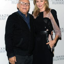 Designers Max, left, and Lubov Azria pose together before the BCBG MAX AZRIA Spring 2013 collection is shown at Fashion Week in New York, Thursday, Sept. 6, 2012.
