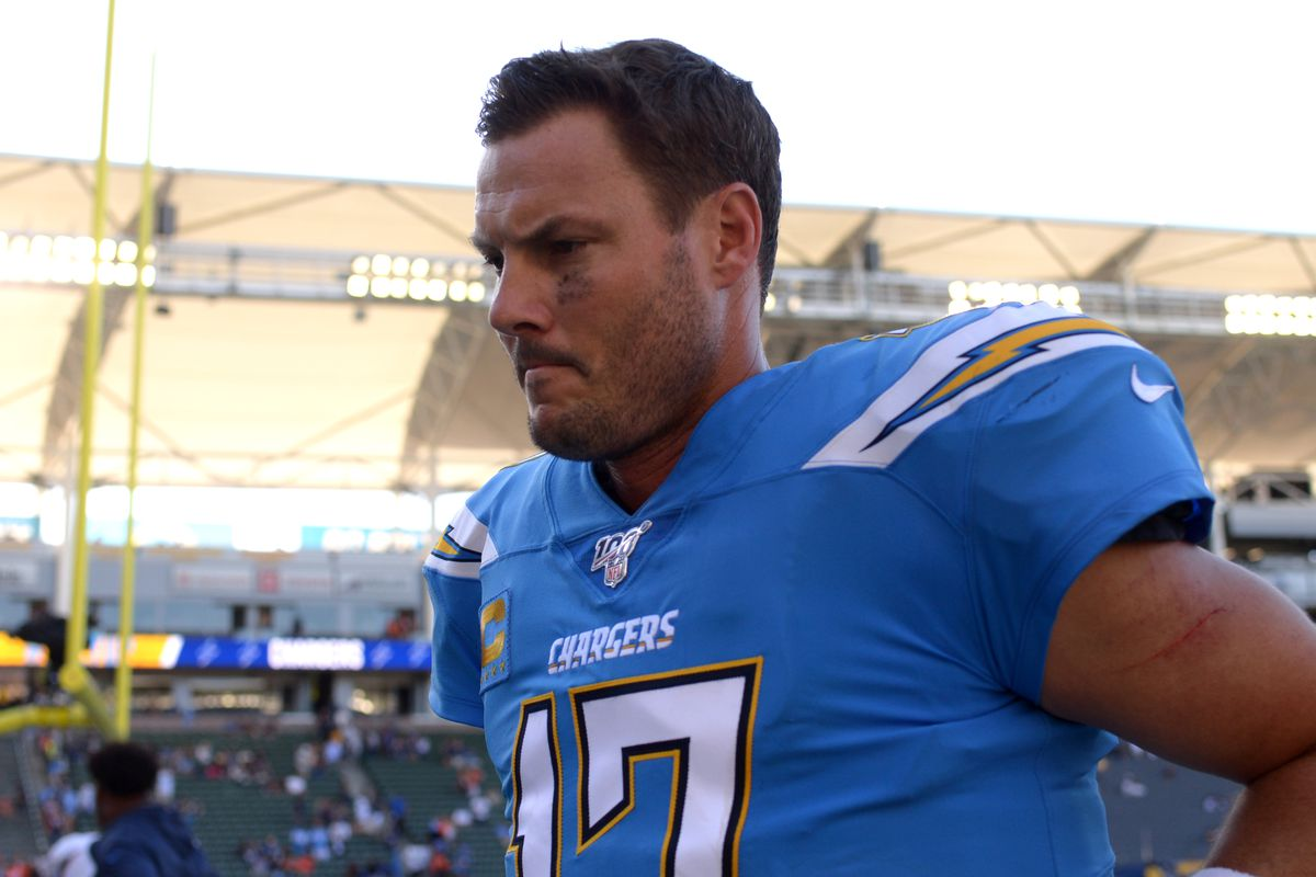 Los Angeles Chargers quarterback Philip Rivers walks off the field after the Chargers were beat 20-13 by the Denver Broncos at Dignity Health Sports Park.