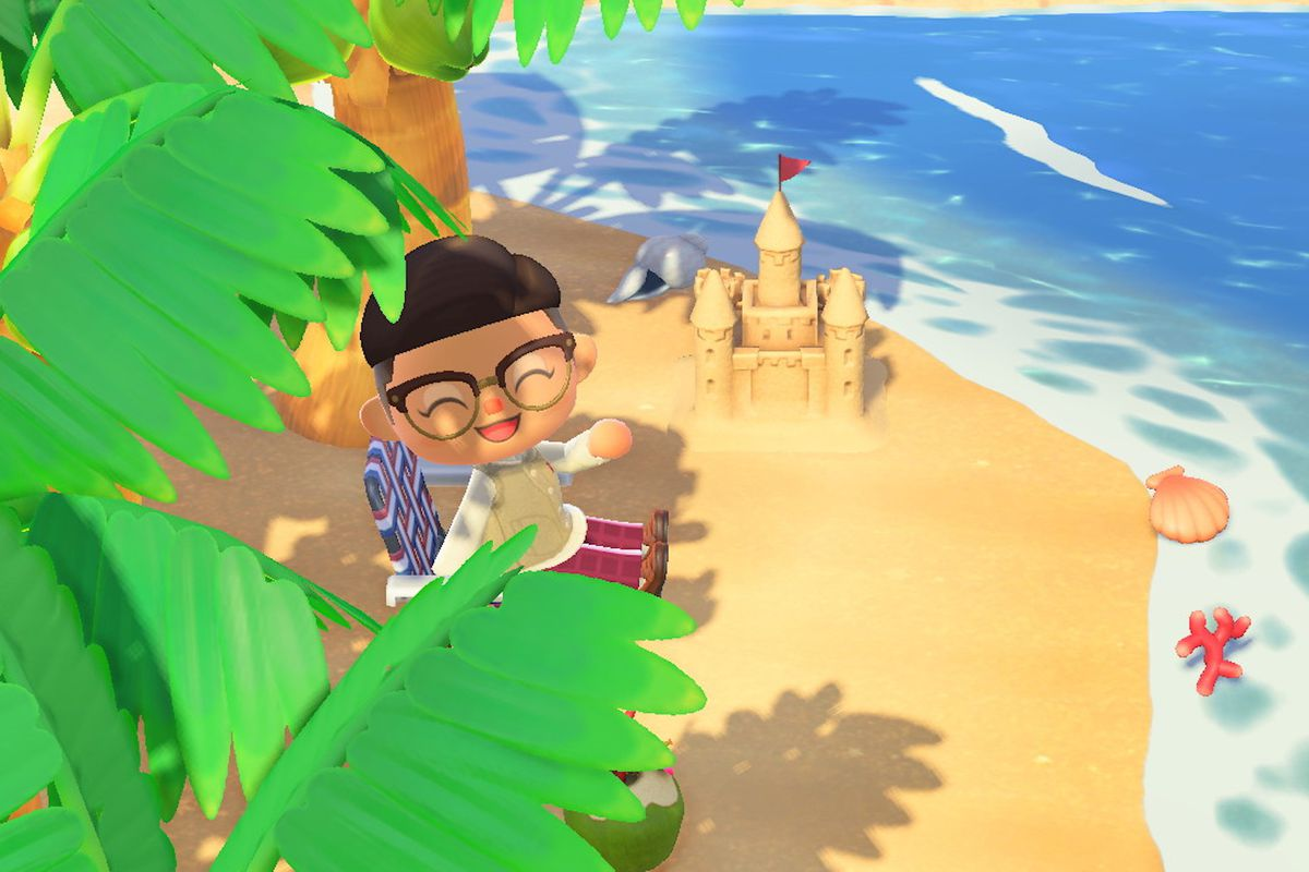 An Animal Crossing player sits at the beach.