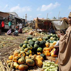 In this photo taken Thursday, March 29, 2012, Somali women sell fruit and vegetables at the Hamarweyne market in Mogadishu, Somalia. The seaside capital of Mogadishu is full of life for the first time in 20 years after African Union and Somali troops pushed Islamist militants out of the city last year.