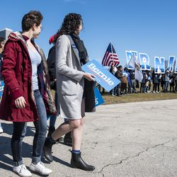 A group of Sanders supporters walk towards the stage to stake out a good spot ahead of the Bernie Sanders rally, Saturday, March 7, 2020 in Grant Park.