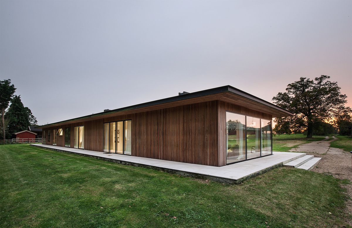 The sleek style of the single story pavilion echoes modernist classics like mies van der rohes farnsworth house and philip johnsons glass house but with a