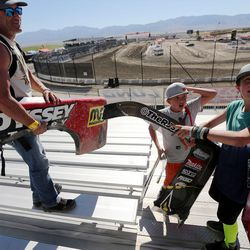 Corey Buchi, his son Kruz, and friend Will Archer take truck parts home as souvenirs after the Pro 2 division in the Lucas Off-Road races in Tooele on Saturday, June 24, 2017.