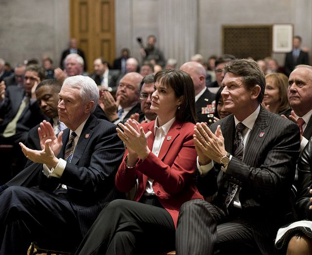 Tennessee Education Commissioner Candice McQueen listens to Haslam's agenda for the state.