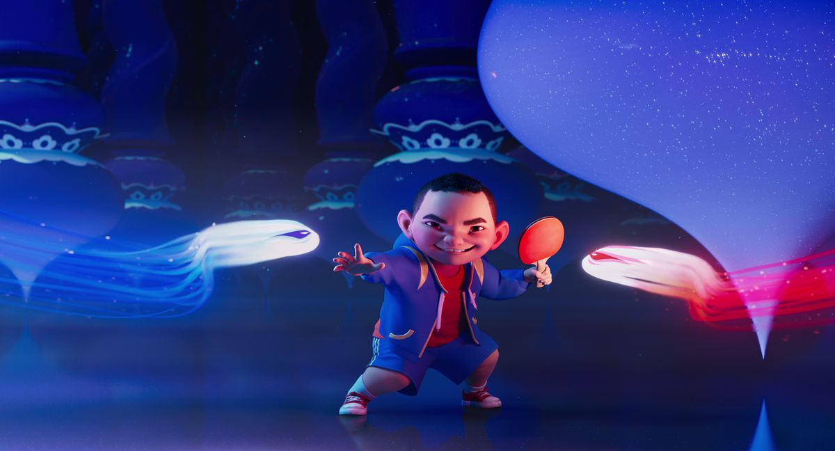 Chin grins and wields a ping-pong paddle (and looks a lot like Dash in The Incredibles) as streaks of light come to attack him in Over the Moon