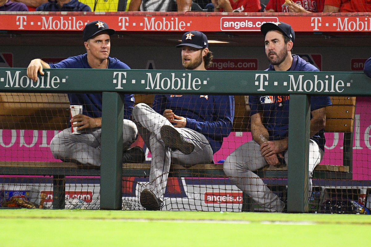 Houston Astros pitchers Zack Greinke, Gerrit Cole, and Justin Verlander look on during a MLB game between the Houston Astros and the Los Angeles Angels of Anaheim on September 26, 2019 at Angel Stadium of Anaheim in Anaheim, CA.