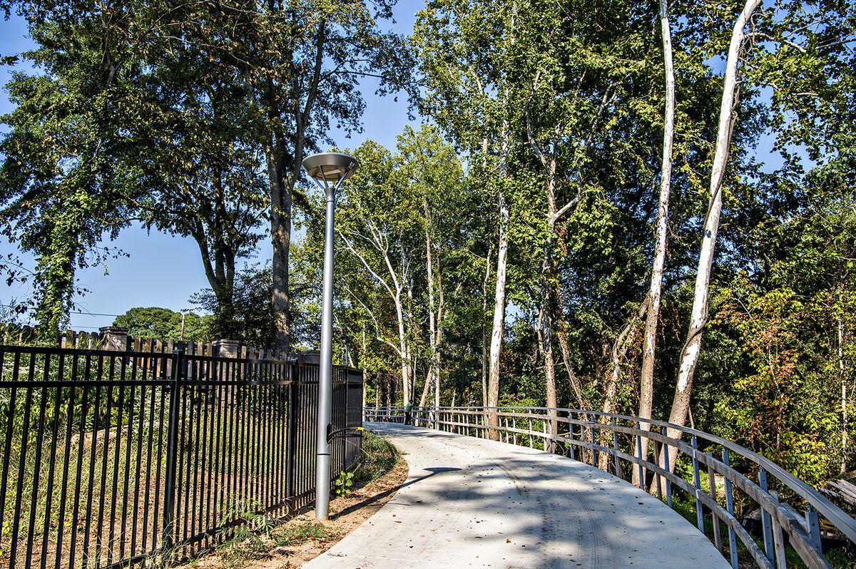 Lighting and handrails along a trail creek.