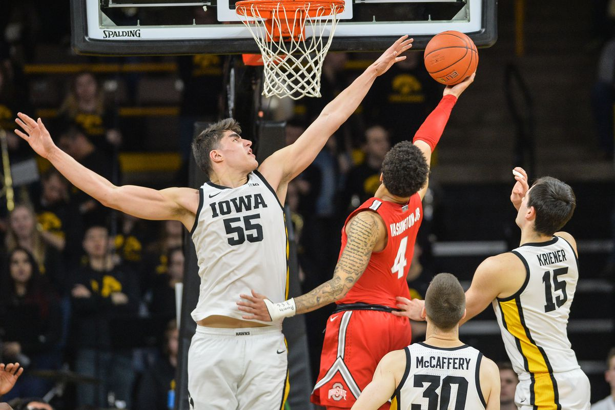 Iowa Hawkeyes center Luka Garza attempts to block the shot of Ohio State Buckeyes guard Duane Washington Jr. as guard Connor McCaffery (30) and forward Ryan Kriener look on during the second half at Carver-Hawkeye Arena.
