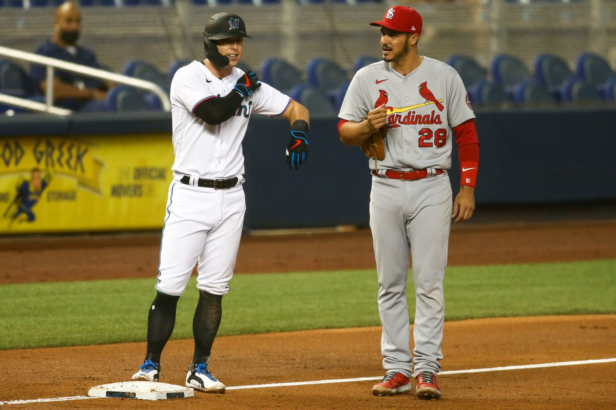 Miami Marlins left fielder Corey Dickerson (23) and St. Louis Cardinals third baseman Nolan Arenado (28) talk during the third inning of the game at loanDepot Park.