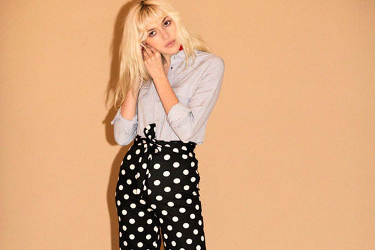 Model in black and white polka dot pants