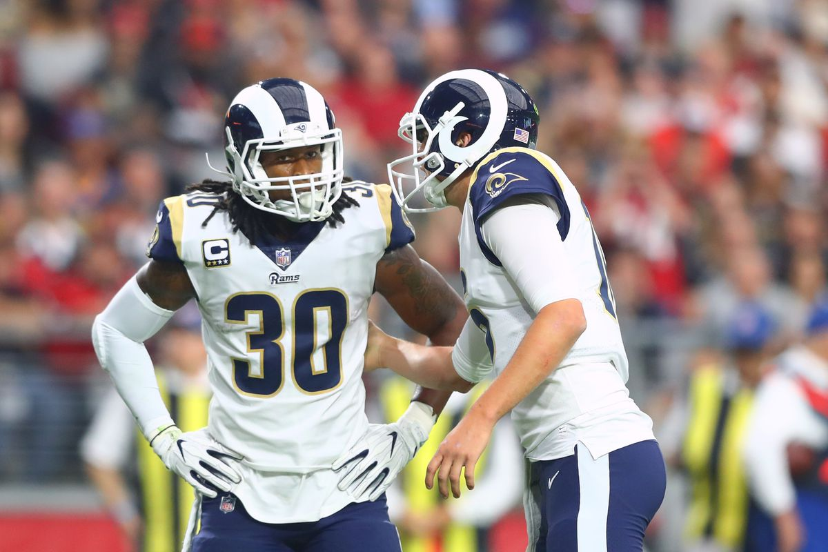 Los Angeles Rams QB Jared Goff talks with RB Todd Gurley in Week 13 against the Arizona Cardinals, Dec. 3, 2017.