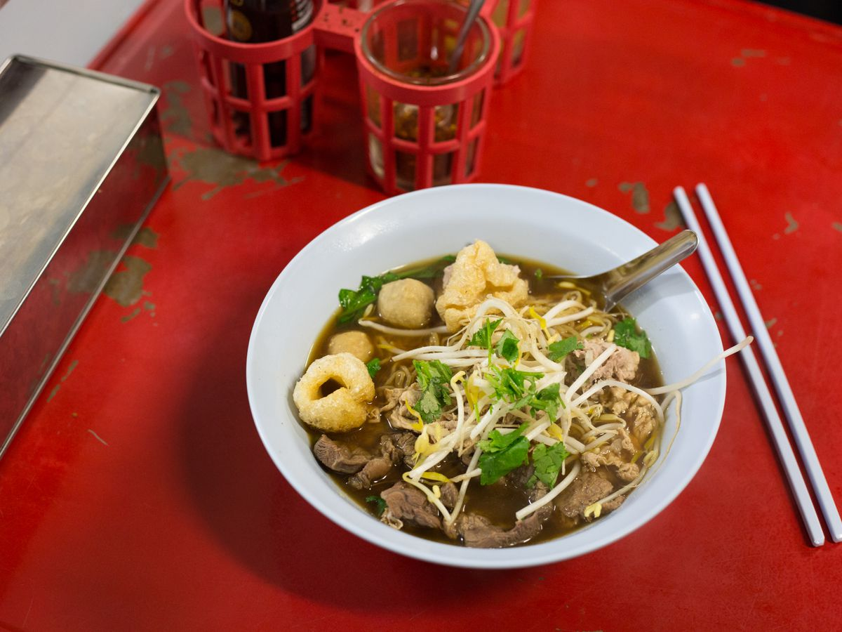 A dish of boat noodles on red tablecloth at Soi 38