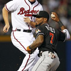 Miami Marlins shortstop Jose Reyes (7) throws to first base after tagging out Atlanta Braves' Chipper Jones (10) on a ground ball from Freddie Freeman (5) in the second inning of a baseball game in Atlanta, Thursday, Sept. 27, 2012.