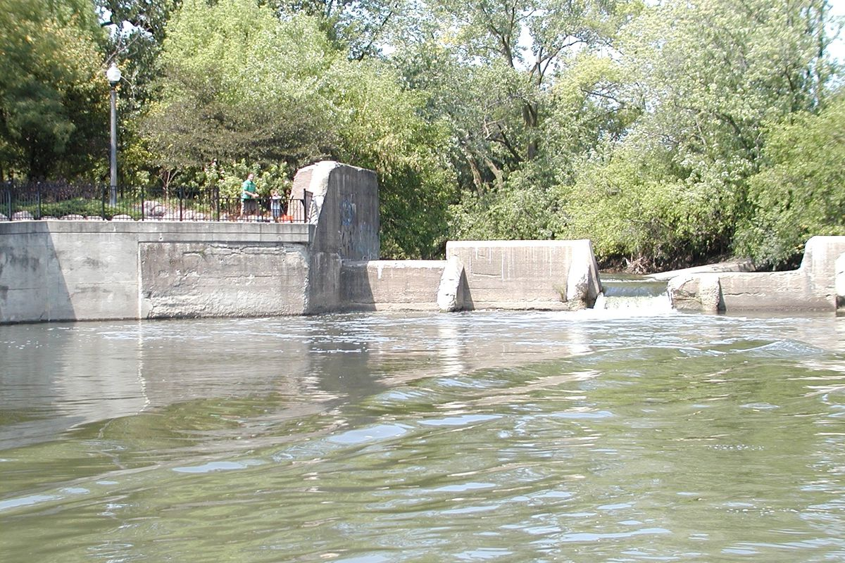 Dams are more than physical structures built on waterways for multiple purposes, they also build memories personally and within society. Take this family in the summer of 2012 fishing at the dam (``The Waterfall'') at the confluence of the North Branch of the Chicago River and the North Shore Channel; the dam was removed in 2018. Credit: Dale Bowman