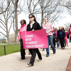 Planned Parenthood supporters walk to a women's rights rally held in early April on Capitol Hill in Washington, D.C.