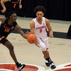 PULLMAN, WA - DECEMBER 2: Oregon State forward Warith Alatishe (10) reaches in on Washington State forward DJ Rodman (11) during the first half of the Pac 12 matchup between the Oregon State Beavers and the Washington State Cougars on December 2, 2020, at Beasley Coliseum in Pullman, WA.