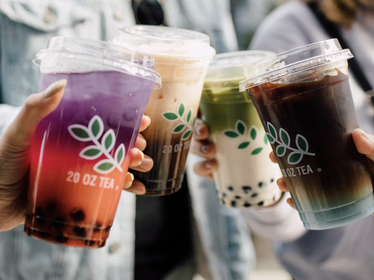 A closeup of four colorful boba teas, with the label 20 Oz Tea on the front of each cup