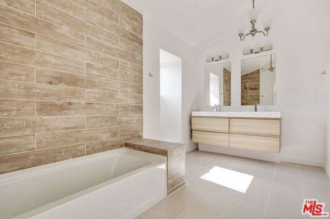 Bathroom with tub and sinks