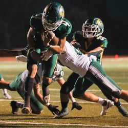 Kearns quarterback Iosefa Toia'ivao (4) carries the ball for the team's second touchdown during a high school football game against Olympus at Kearns High School in Kearns on Friday, Aug. 28, 2020.