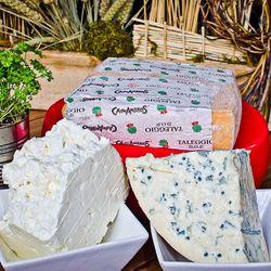 10 lbs of feta per week; 6 lbs of gorgonzola per week; 10 lbs of fontina per week; 10 lbs tallegio per week