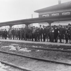 A historical photo of Utah soldiers waiting for transportation to World War I from Salt Lake's Rio Grande Depot.