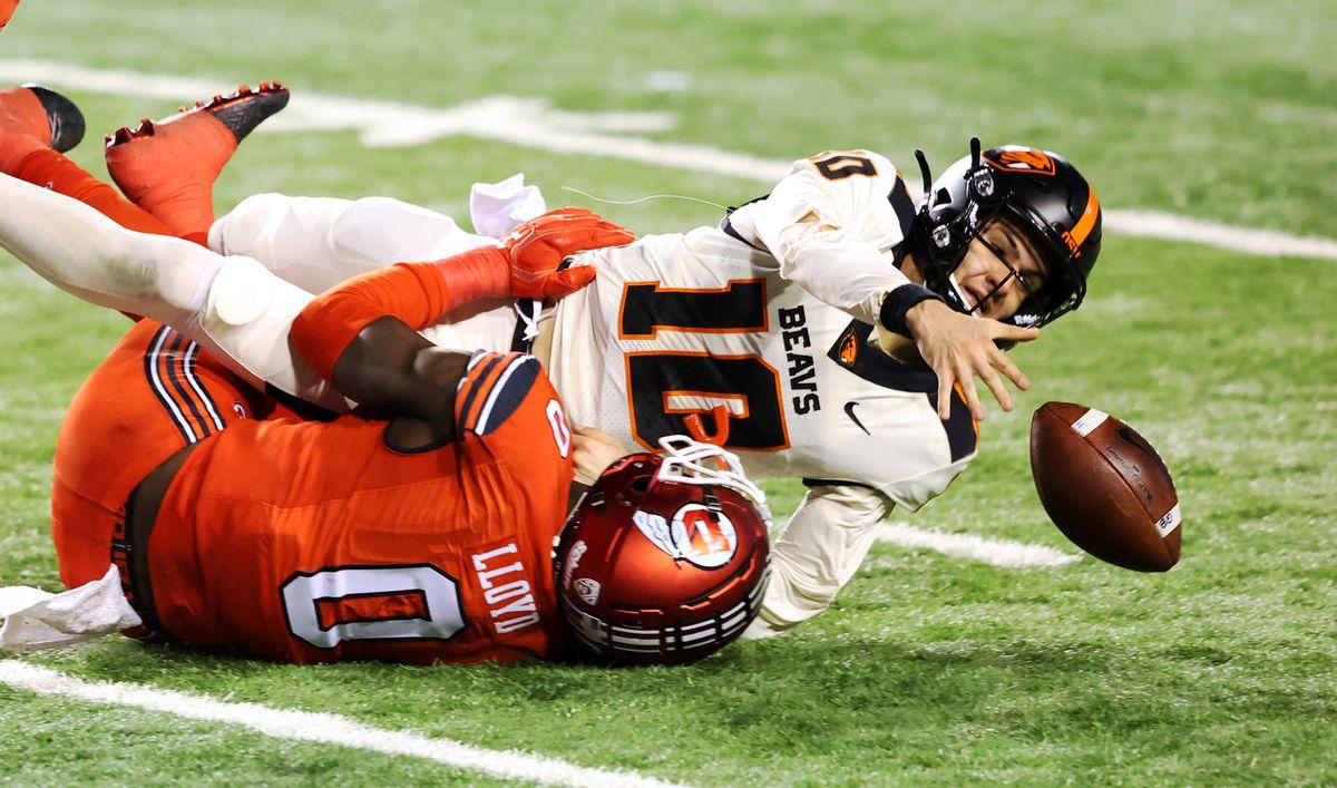 Utah linebacker Devin Lloyd sacks Oregon State quarterback Chance Nolan during game at Rice-Eccles stadium in Salt Lake City.