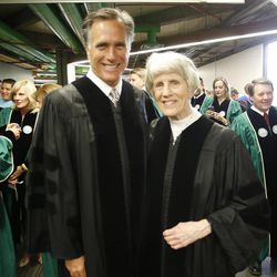 Former presidential candidate and Massachusetts Gov. Mitt Romney poses with Pamela Atkinson prior to commencement  at Utah Valley University in Orem Thursday, April 30, 2015.