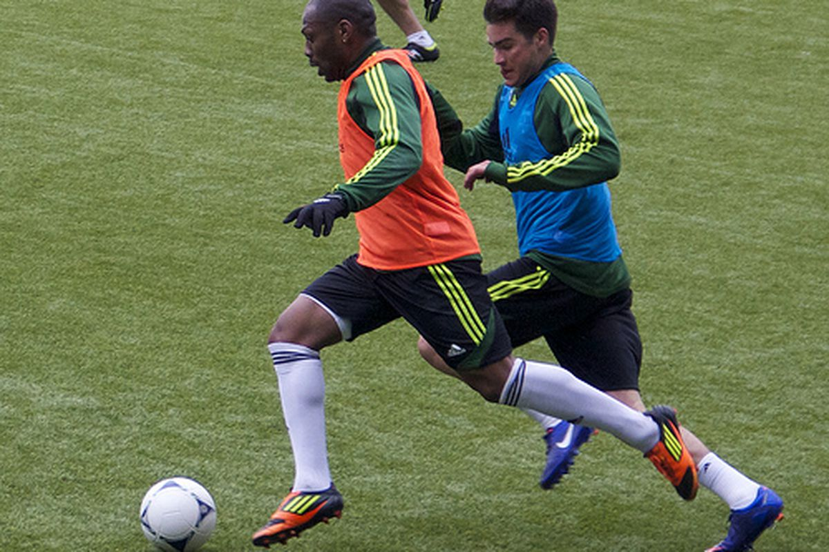 """Franck Songo'o dribbles past Chris Taylor during the Portland Timbers practice on 2/17/12 (via <a href=""""http://www.flickr.com/photos/76872557@N07/6894196065/"""">William Conwell</a>)"""