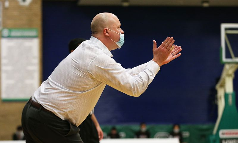 DePaul Prep coach Tom Kleinschmidt encourages his players during the championship game of the Chipotle Classic.