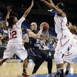 BYU's Lexi Eaton (21), looks to shoot as she is defended by North Carolina State's Krystal Barrett (12), Kody Burke (44) during the first half of a first-round game in the NCAA women's college basketball tournament on Saturday, March 22, 2014, in Los Angeles. (AP Photo/Jae C. Hong)