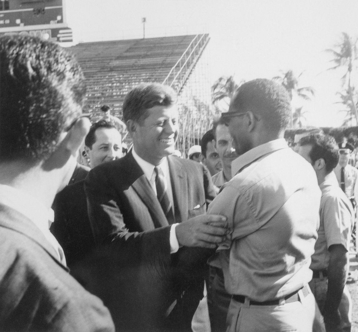 John Kennedy Receiving an Embrace
